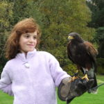 girl with harris hawk